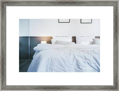 Unmade Bed Framed Print by Atiketta Sangasaeng