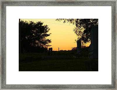 Unsettling Sun Framed Print by Carl Perry