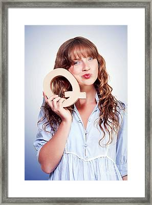 Unsure Female Student With Letter Q For Question Framed Print by Jorgo Photography - Wall Art Gallery
