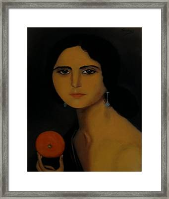 Untitled Woman With Orange Framed Print by Manuel Sanchez