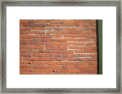 Up Against A Wall Framed Print