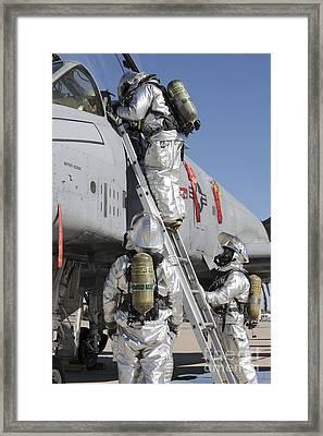 U.s. Air Force Airmen Perform A Rescue Framed Print