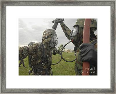 U.s. Air Force Soldier Decontaminates Framed Print by Stocktrek Images