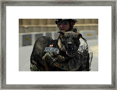 U.s. Air Force Soldier Giving Framed Print by Stocktrek Images