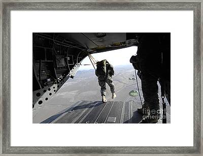U.s. Airmen Jump From A Ch-47 Chinook Framed Print by Stocktrek Images