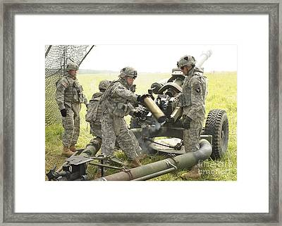U.s. Army Soldier Throws A Spent 105mm Framed Print
