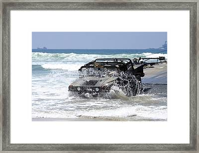 U.s. Army Soldiers Offload A Humvee Framed Print by Stocktrek Images