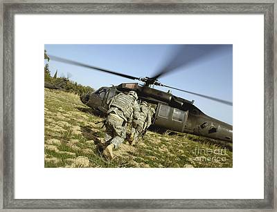 U.s. Army Soldiers Prepare To Board Framed Print