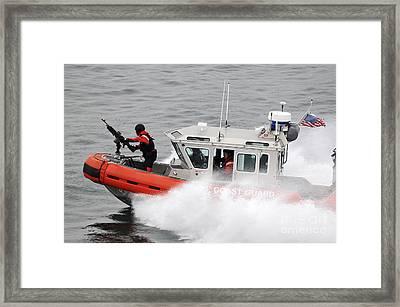 U.s. Coast Guardsmen Aboard A Security Framed Print