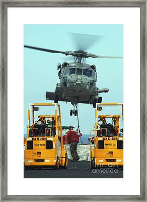 U.s. Navy Sailors Attach A Sling Framed Print
