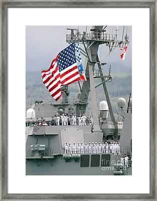 U.s. Navy Sailors Line The Rails Aboard Framed Print by Stocktrek Images