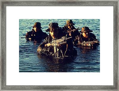 Us Navy Seal Team Emerges From Water Framed Print by Everett