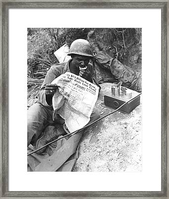 U.s. Soldier Reads The Latest News Framed Print by Stocktrek Images