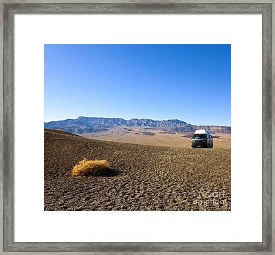 Vehicle In Desert Landscape Framed Print