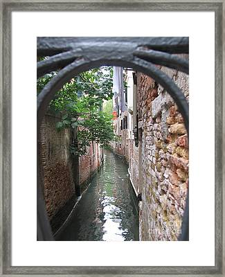 Venice Canal Through Gate Framed Print