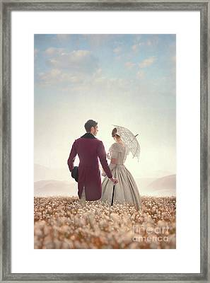 Victorian Couple Standing In A Meadow Framed Print by Lee Avison