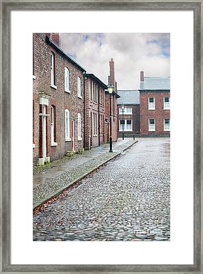 Victorian Terraced Street Of Working Class Red Brick Houses Framed Print by Lee Avison