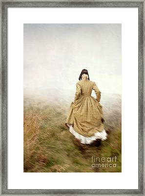 Victorian Woman Running On The Misty Moors Framed Print