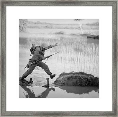 Vietnam War. A Us Marine Rifleman Leaps Framed Print by Everett