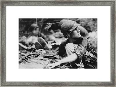 Vietnam War. Army Medic Searches Framed Print