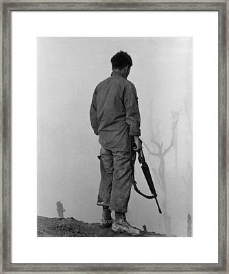 Vietnam War. Us Infantryman Looks Framed Print