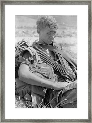 Vietnam War. Us Marine Takes A Break Framed Print by Everett