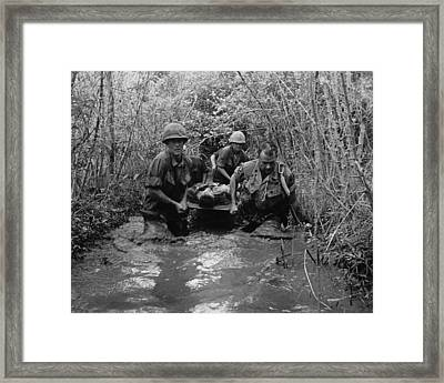 Vietnam War. Us Soldiers Carry Framed Print