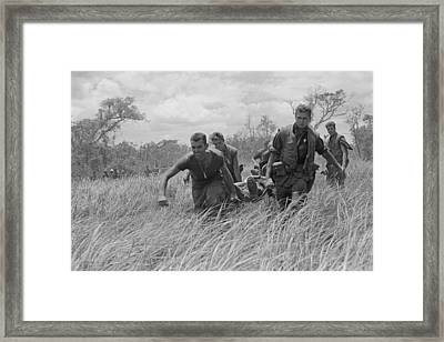Vietnam War. While Under Heavy Fire, Us Framed Print by Everett