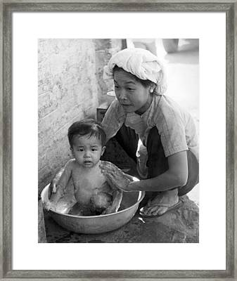 Vietnamese Orphan Bathing Framed Print by Underwood Archives