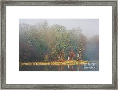view across Yew Tree Tarn in the mist Framed Print