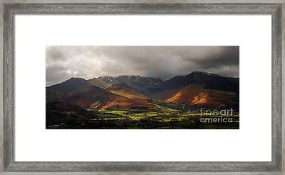 Storm Clouds Over The Western Fells Framed Print by John Collier