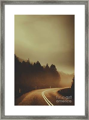 View Of Abandoned Country Road In Foggy Forest Framed Print