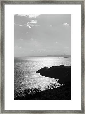 Framed Print featuring the photograph View Of Howth Head With The Baily Lighthouse In Black And White by Semmick Photo