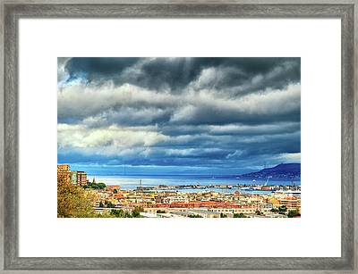 Framed Print featuring the photograph View Of Messina Strait Sicily With Dramatic Sky by Silvia Ganora