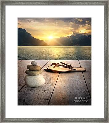 View Of Sandals And Rocks On Dock  Framed Print