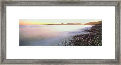 View Of Sunrise Over Pacific Ocean Framed Print by Panoramic Images