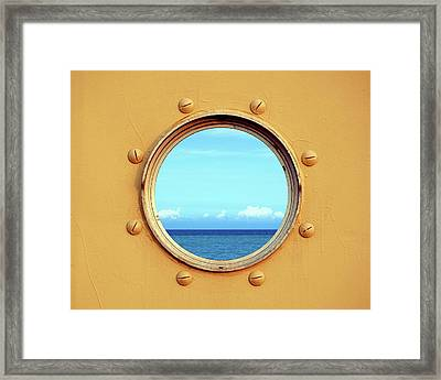 View Of The Ocean Through A Porthole Framed Print by Yali Shi