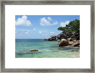 View Of The Sea And A Rocky Coastline Framed Print by Caspar Benson