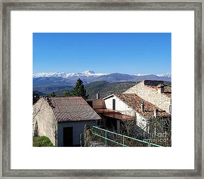 Village Rooftops Framed Print by Judy Kirouac