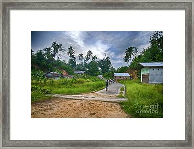 Framed Print featuring the photograph Village Scene by Charuhas Images