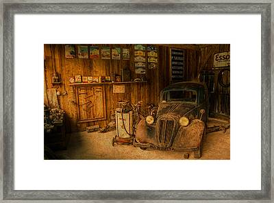 Vintage Auto Repair Garage With Truck And Signs Framed Print by Design Turnpike