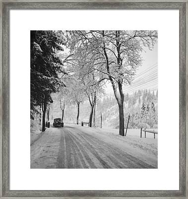 Vintage Car On A Winter Road Framed Print by German School
