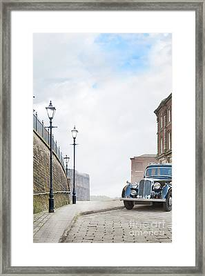 Vintage Car Parked On The Street Framed Print