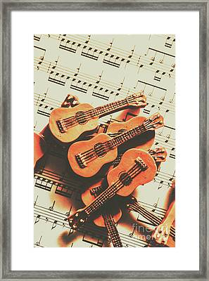 Vintage Guitars On Music Sheet Framed Print by Jorgo Photography - Wall Art Gallery