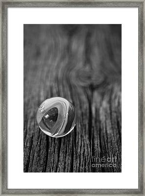 Vintage Marble On Old Wooden Floor Framed Print by Edward Fielding