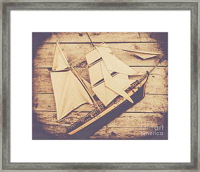 Vintage Mini Ship On Wooden Background Framed Print by Jorgo Photography - Wall Art Gallery
