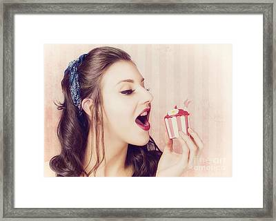Vintage Pin Up Girl Eating Strawberry Cupcake Framed Print by Jorgo Photography - Wall Art Gallery