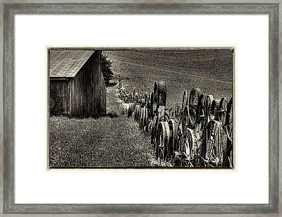 Vintage Wheel Fence Framed Print by David Patterson