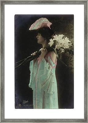 Vintage Woman In Gown Holding Lilies Framed Print by Gillham Studios