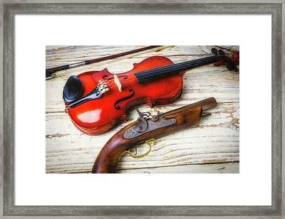 Violin And Pistole Framed Print